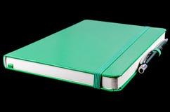 Cuaderno verde Imagen de archivo