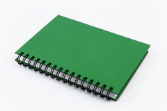 Cuaderno verde aislado Imagen de archivo libre de regalías