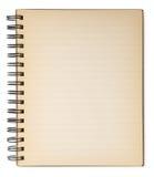 Cuaderno viejo aislado en blanco. Fotografía de archivo