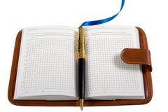 Cuaderno y bolígrafo Imagen de archivo libre de regalías