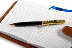 Cuaderno y bolígrafo Imagenes de archivo