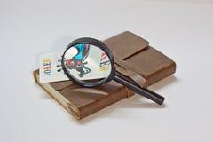 Cuaderno y bromista detectives Foto de archivo libre de regalías