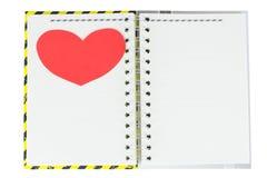 Cuaderno y corazón Fotografía de archivo