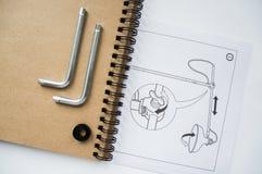 Cuaderno y detalles de la lámpara Fotografía de archivo libre de regalías