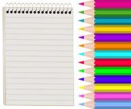 Cuaderno y lápices ilustración del vector