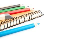 Cuaderno y lápices Fotografía de archivo