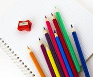 Cuaderno y lápices de la escuela Fotos de archivo libres de regalías