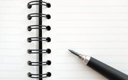 Cuaderno y lápiz Fotos de archivo libres de regalías
