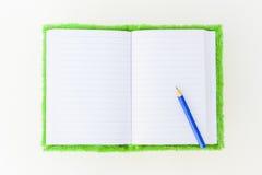 Cuaderno y lápiz imagen de archivo libre de regalías