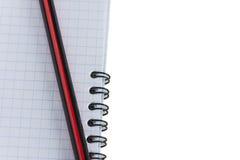 Cuaderno y lápiz en a Foto de archivo libre de regalías