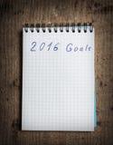 Cuaderno y metas del Año Nuevo 2016 Imágenes de archivo libres de regalías