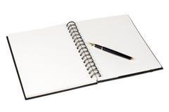 Cuaderno y pluma foto de archivo