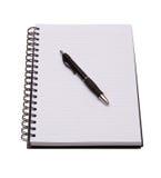 Cuaderno y pluma aislados en blanco Foto de archivo