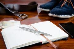 Cuaderno y sistema de accesorios para hombre del número Foto de archivo libre de regalías