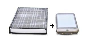 Cuaderno y teléfono elegante foto de archivo libre de regalías