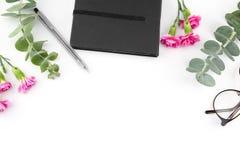 Cuaderno y vidrios negros Fotos de archivo libres de regalías
