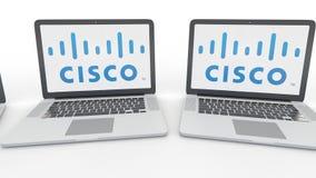 Cuadernos con el logotipo de Cisco Systems en la pantalla Clip conceptual del editorial 4K de la informática, lazo inconsútil stock de ilustración