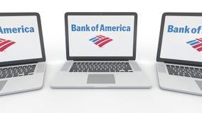 Cuadernos con la Bank of America el logotipo en la pantalla Representación conceptual del editorial 3D de la informática Imagen de archivo libre de regalías