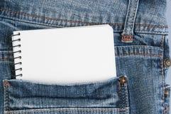 Cuadernos en bolsillo de los vaqueros Foto de archivo libre de regalías