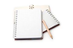 Cuadernos y lápiz Imagenes de archivo