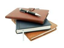 Cuadernos y pluma fotos de archivo