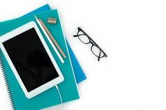 Cuadernos y tableta digital Fotografía de archivo libre de regalías