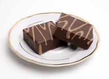 Cuadrados del chocolate en un platillo Fotos de archivo libres de regalías