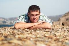 Cuadro de un hombre en la playa Fotografía de archivo libre de regalías