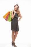 Cuadro del adolescente con los bolsos de compras Imágenes de archivo libres de regalías
