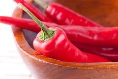 Cuadro macro de chiles rojos Fotografía de archivo libre de regalías