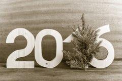 Cuadros de madera ligeros 2016 y rama del árbol de navidad en GR Imagen de archivo libre de regalías