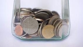Cualquier moneda en la taza de cristal Fotografía de archivo