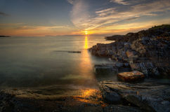 Cuan Sound coast. Rocky coast of Cuan Sound with sunset in background, Highland, Scotland stock photo