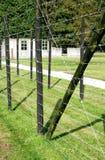 Cuartel detrás del alambre de púas en un campo de concentración Imágenes de archivo libres de regalías