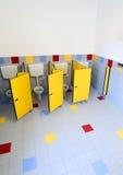 Cuartos de baño del cuarto de niños con las puertas de cabinas Imagen de archivo libre de regalías