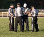 Cuatro árbitros del fútbol Fotos de archivo libres de regalías