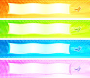 Cuatro banderas coloridas con los aeroplanos retros Fotografía de archivo