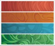 Cuatro banderas diferentemente adornadas Fotos de archivo libres de regalías