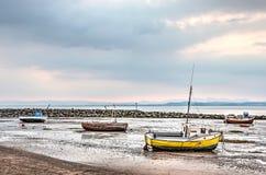 Cuatro barcos en la playa Foto de archivo libre de regalías
