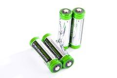 Cuatro baterías recargables aisladas en blanco Fotos de archivo libres de regalías