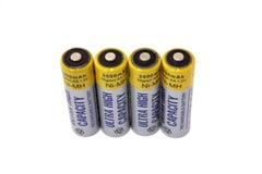 Cuatro baterías rechargable aisladas Foto de archivo