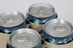 Cuatro latas de las bebidas. Imagen de archivo libre de regalías