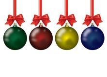 Cuatro bolas de la Navidad aisladas en el fondo blanco Imágenes de archivo libres de regalías