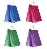 Cuatro bolsos de compras del color Imagenes de archivo