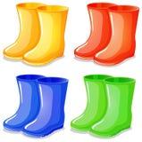 Cuatro botas en diversos colores Fotos de archivo libres de regalías