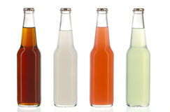 Cuatro botellas de soda clasificadas, bebidas alcohólicas Foto de archivo libre de regalías