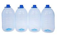 Cuatro botellas grandes de agua (trayectoria de recortes) Fotos de archivo libres de regalías