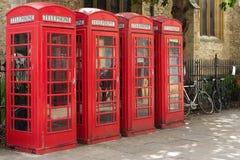 Cuatro cabinas de teléfonos rojas Fotografía de archivo libre de regalías