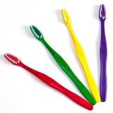 Cuatro cepillos de dientes Foto de archivo libre de regalías