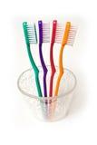Cuatro cepillos de dientes Imagen de archivo libre de regalías